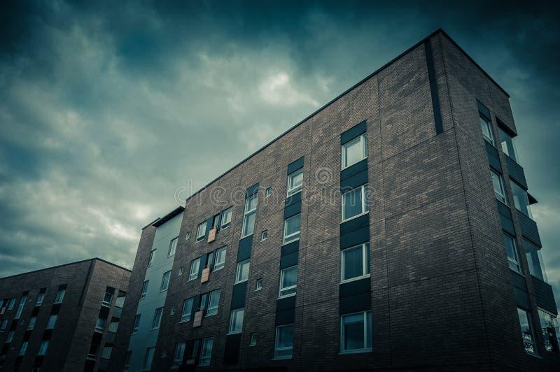 Apartment block. Grungy apartment block at twilight royalty free stock photos