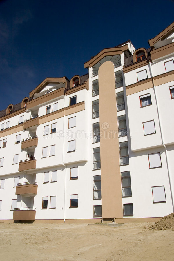 Apartment block. Moder apartment block in construction royalty free stock photography