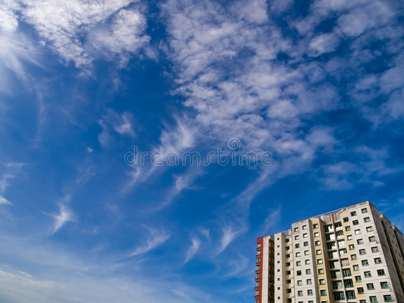 Apartment Block. A public housing apartment block in a cloudy blue sky in the early morning stock photography