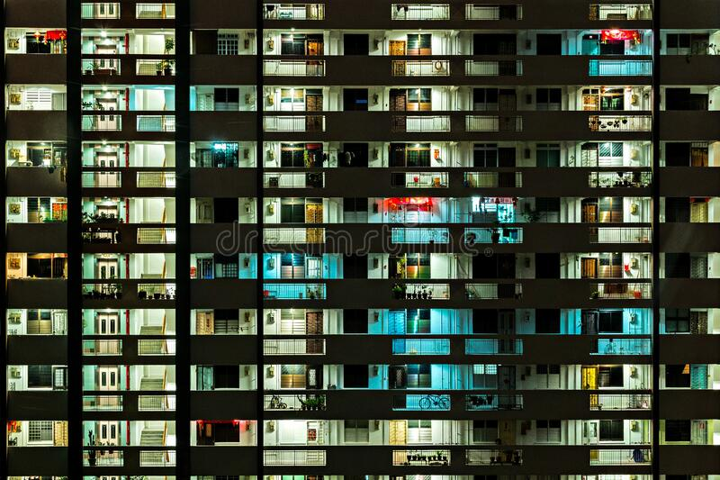 Apartment block illuminated at night royalty free stock photography