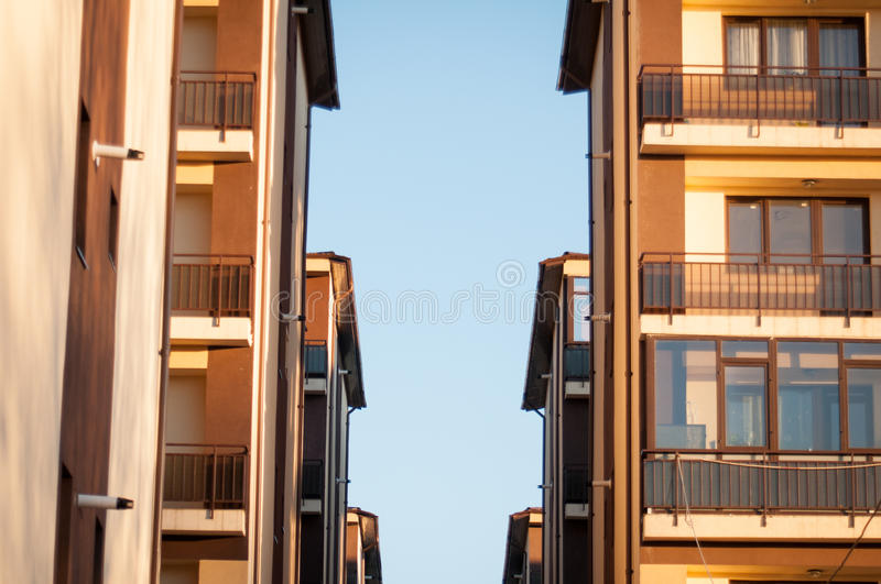 Apartment block in rows. Apartment block at sunset in bucharest stock image