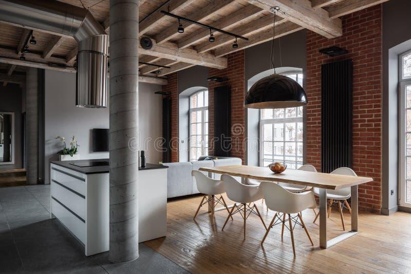 Spacious apartment with brick wall stock photo