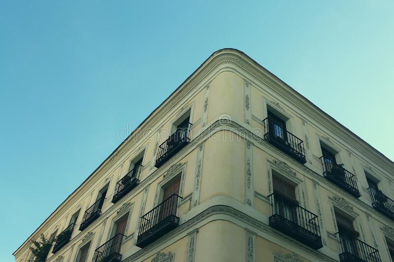 Apartment building against blue skies stock photography