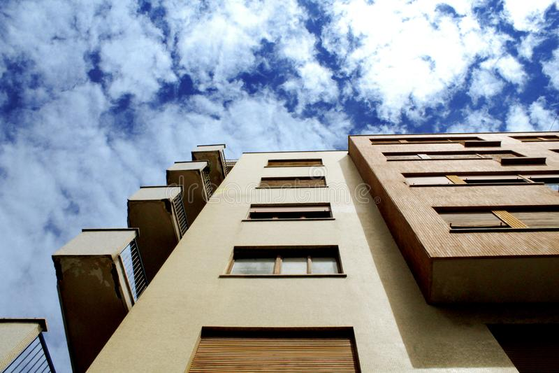 Apartment building against blue skies royalty free stock image