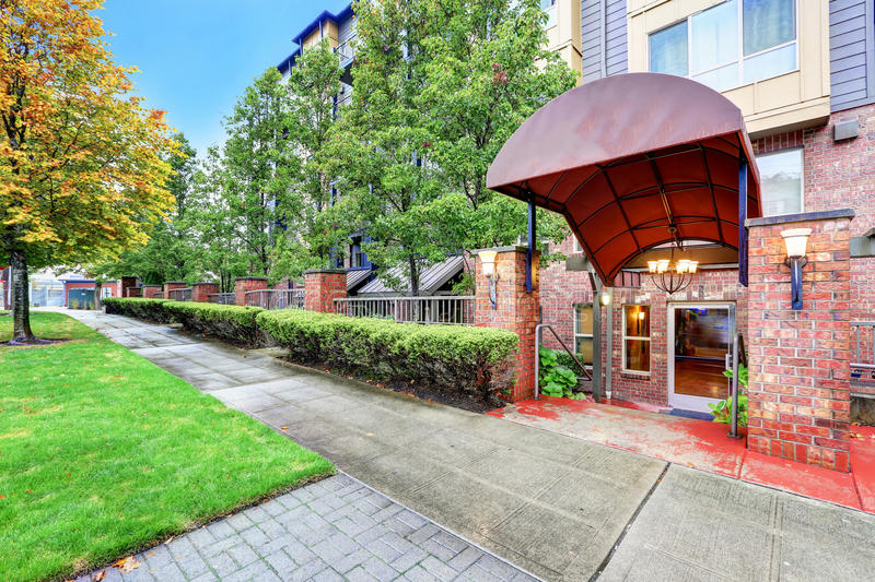 apartment building entrance red brick columns with lanterns stock