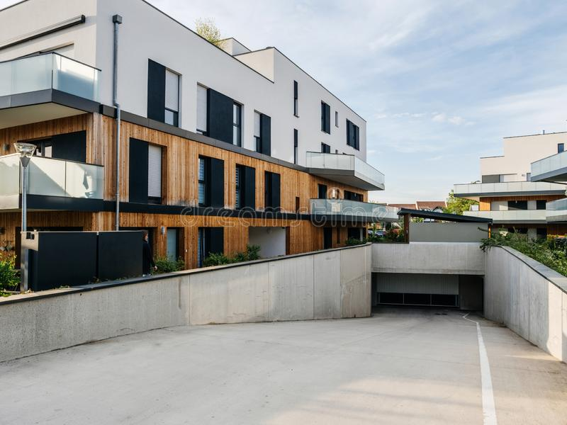 Apartment building with large garage royalty free stock image
