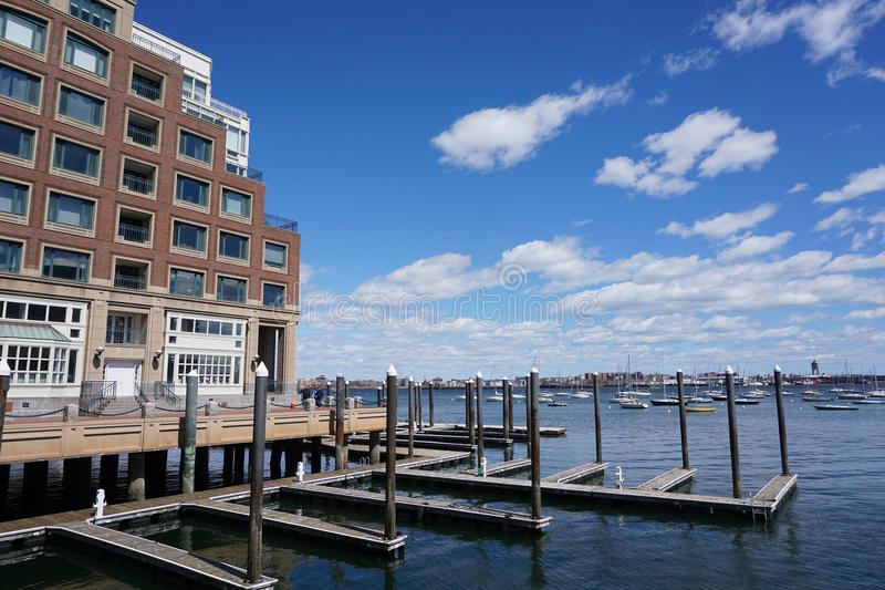 apartment building near sea harbor in Boston royalty free stock image