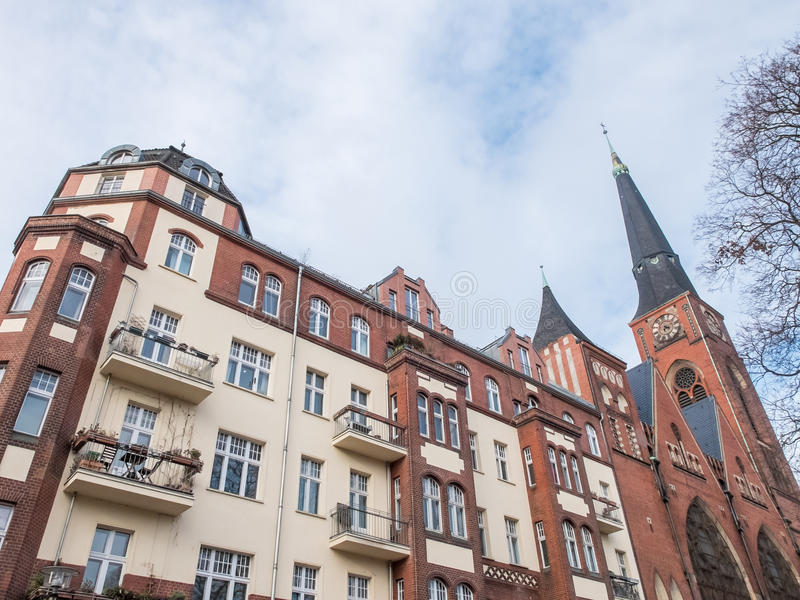 Apartment Building and Old Church with Clock Tower stock photography