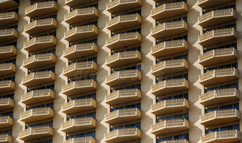 Apartment Building. Row upon row of repeating balconies on an apartment building stock photo