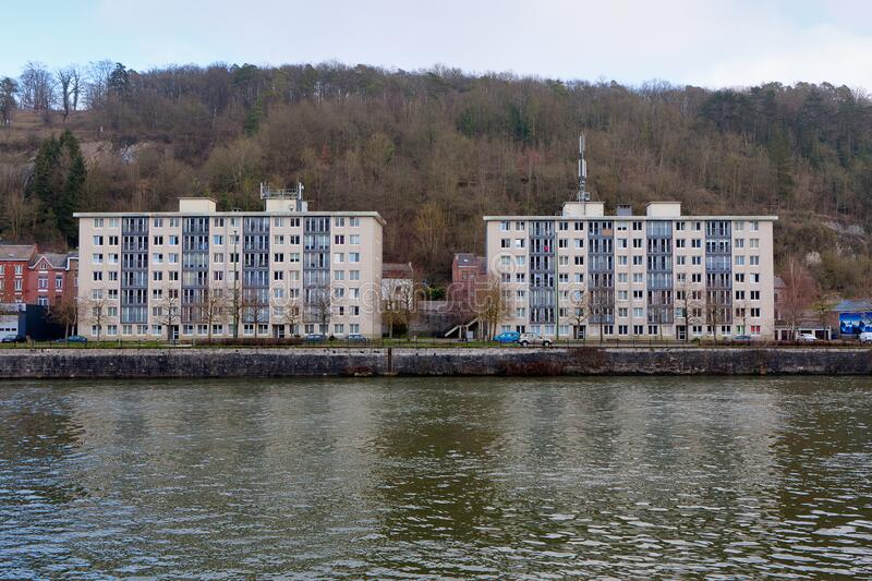 Apartment buildings bank Meuse, Leffe, Dinant, Belgium royalty free stock photos