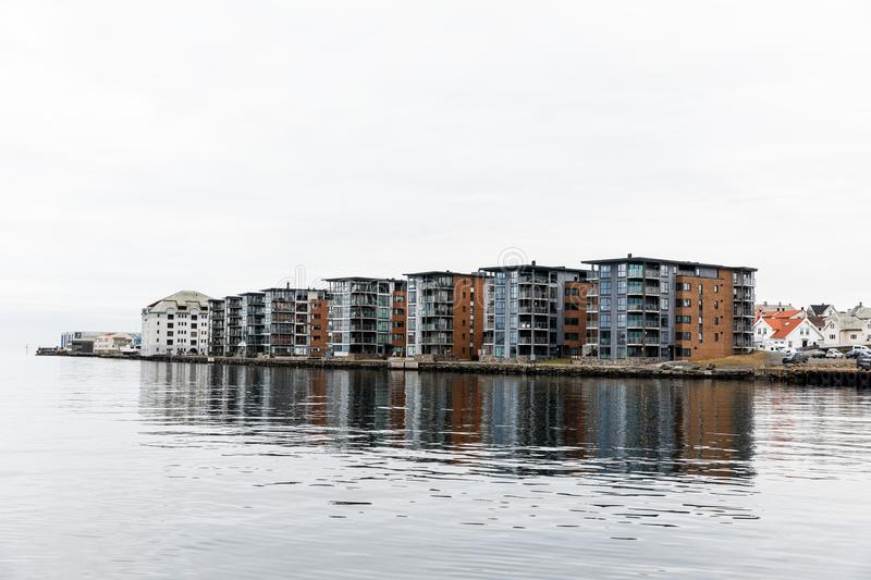 Apartment buildings at Hasseloy, in the city of Haugesund, Norway. The Bridge to Risoya, sailboats in the canal in the city of Haugesund, Norway. Clouds, calm stock photos
