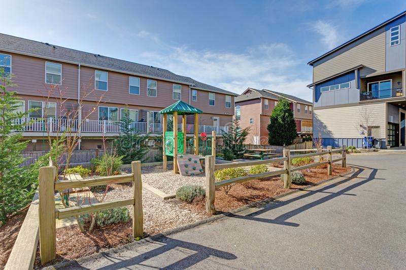 Apartment complex building with kids playground. On a sunny day royalty free stock photos