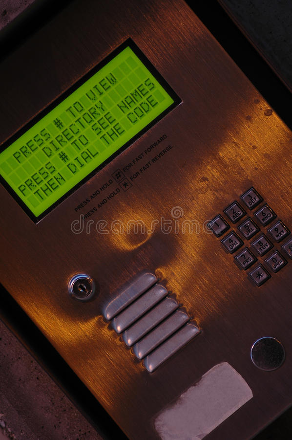 Apartment Directory. Close up of the dialing message to use a directory of an apartment building stock image