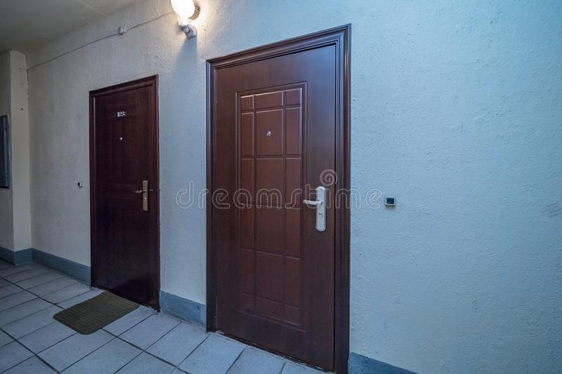 Apartment doors entrance. Residential building apartment doors entrance with door bell stock photography