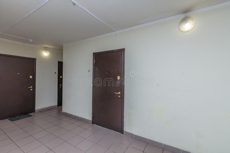 Apartment doors entrance. Residential building apartment doors entrance with door bell stock image