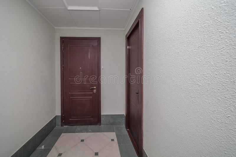 Apartment doors entrance. Residential building apartment doors entrance with door bell stock images
