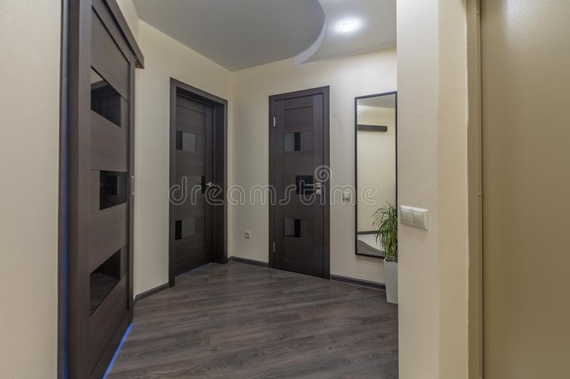 Apartment doors entrance. Residential building apartment doors entrance with door bell royalty free stock images