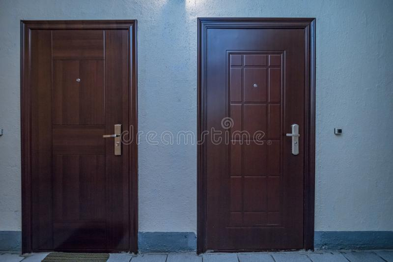 Apartment doors entrance. Residential building apartment doors entrance with door bell royalty free stock photography