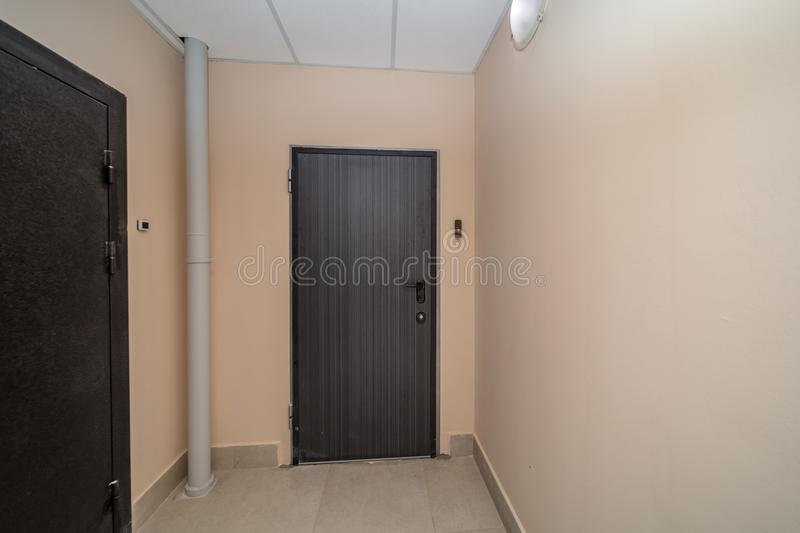 Apartment doors entrance. Residential building apartment doors entrance with door bell stock photos