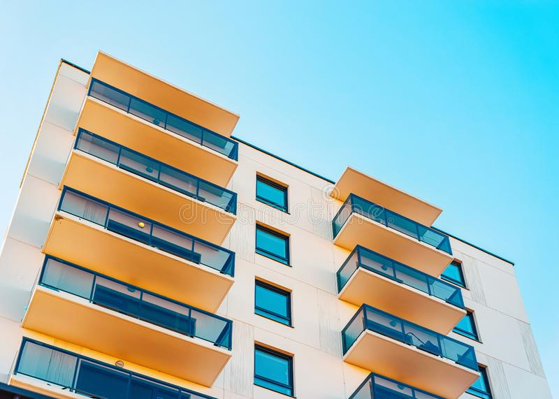Apartment EU residential home facade and empty place copy space. Apartment EU residential home facade and an empty place for the copy space. Blue sky on the royalty free stock photo