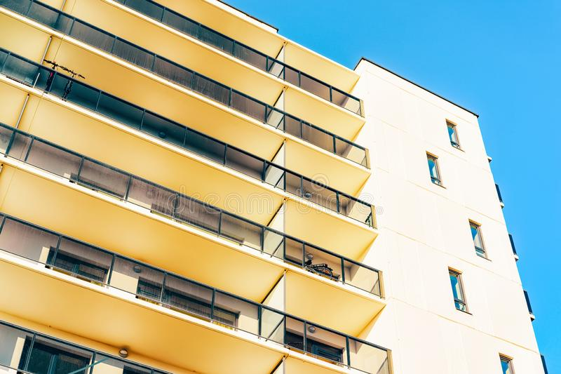 Apartment EU residential house facade and blank copy space. Apartment EU residential house facade and an blank copy space. Blue sky on the background stock images