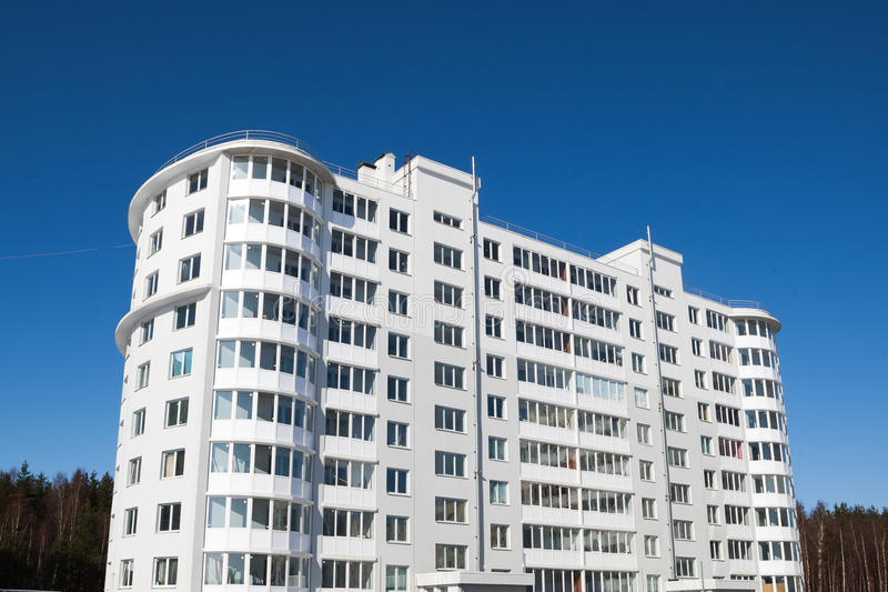 Apartment house. Generic apartment house on blue sky background stock images
