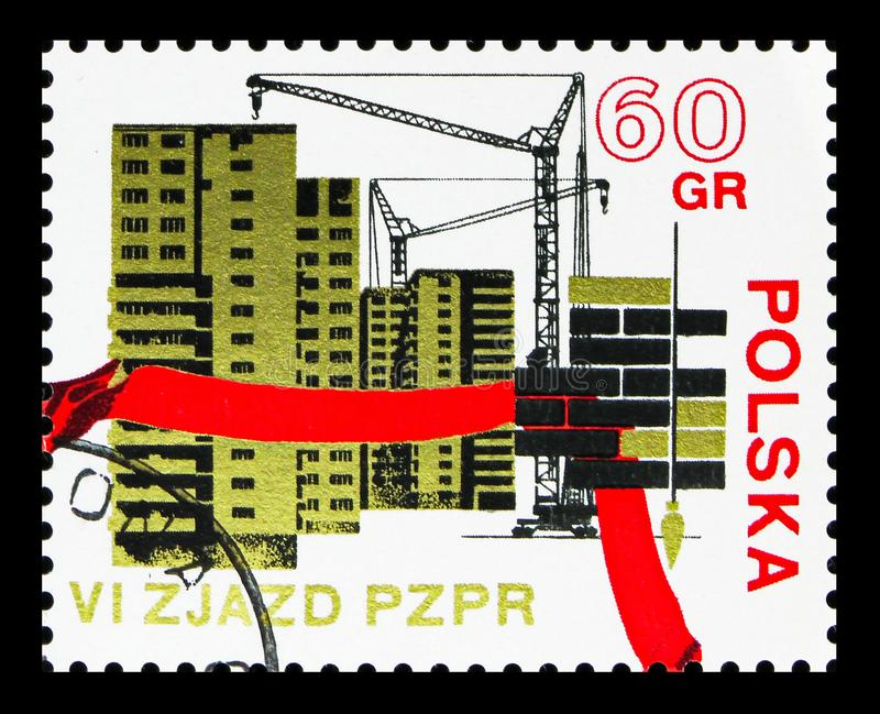 Apartment houses under costruction, 6th Congress Of The Polish United Worker's Party serie, circa 1971. MOSCOW, RUSSIA - SEPTEMBER 15, 2018: A stamp printed in stock illustration