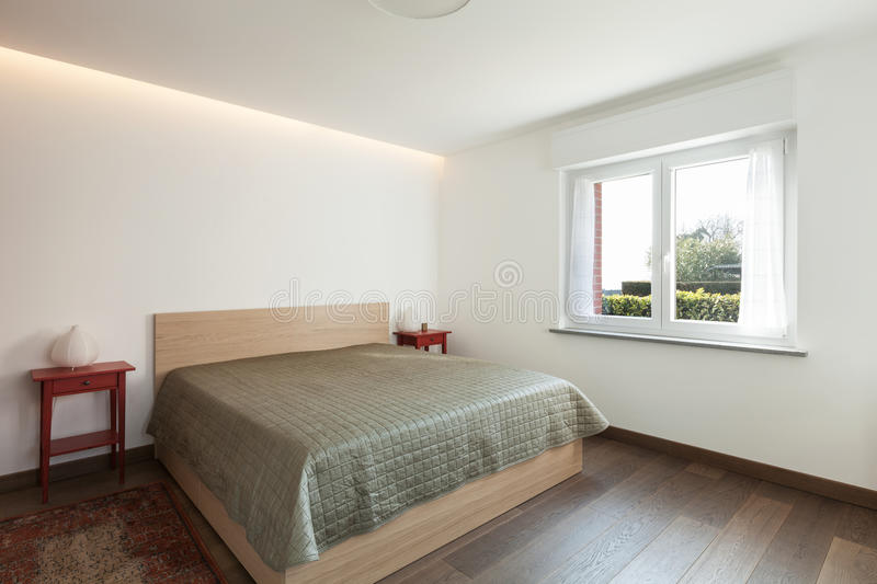Apartment interior, simple bedroom stock images