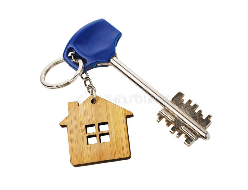 Apartment keys with keychain in the shape of a house royalty free stock photography