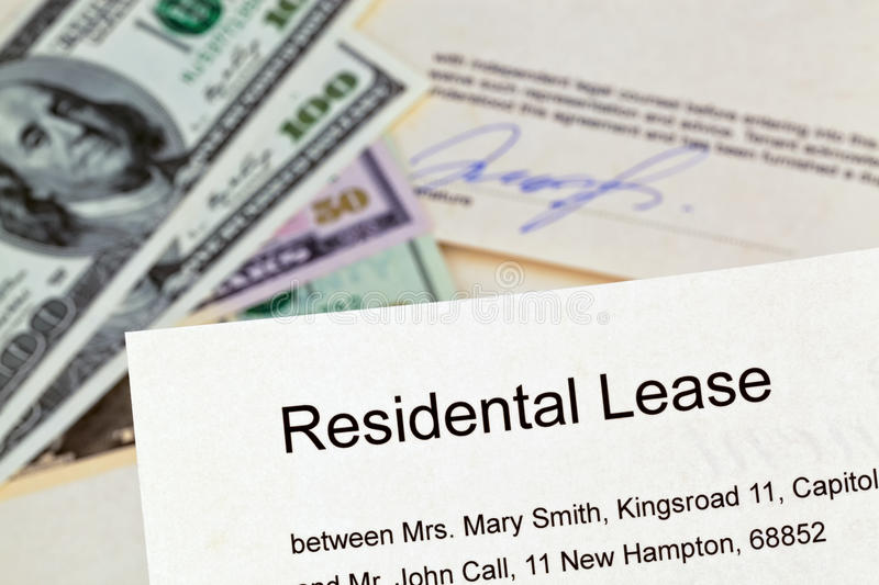 Apartment keys and rental agreement royalty free stock images