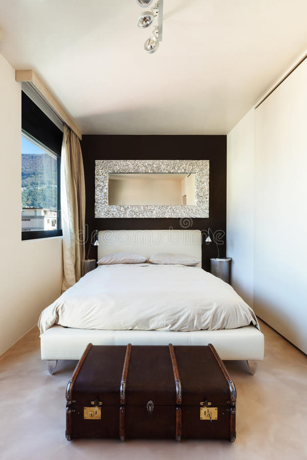 Apartment in new building. Comfortable double bed royalty free stock photos