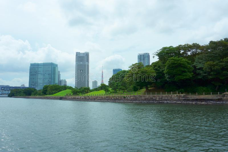 Apartment and office buildings, japanese garden on the Sumida River Tokyo stock photography
