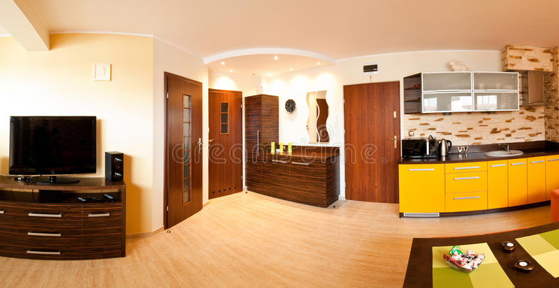 Apartment with open kitchen. An apartment with an open kitchen stock image