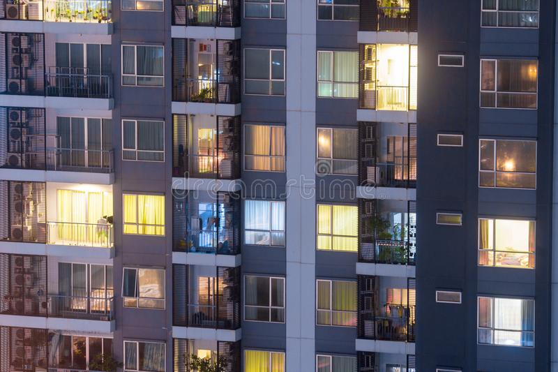 Apartment privacy concept at night with lighting and electricity use rising yearly. Apartment windows at night. royalty free stock photo