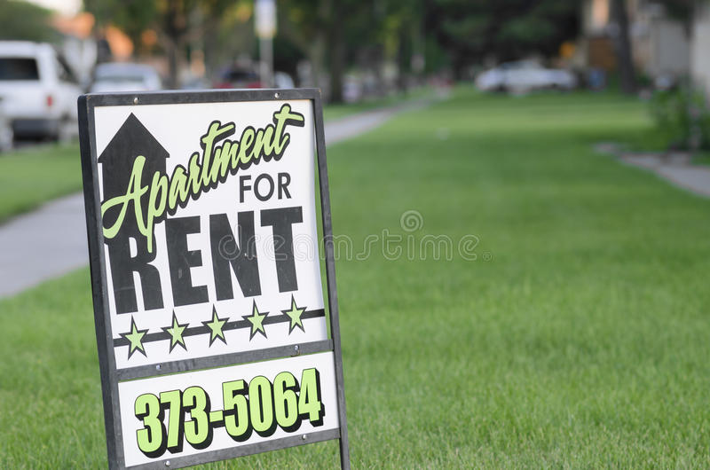 Apartment for Rent Post Sign In American Suburb. Moorhead, Minnesota, United States - July 21, 2015: Green and black designed apartment for rent sign in stock images