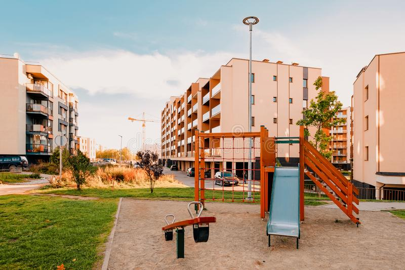Apartment residential house facade architecture and child playground. And outdoor facilities. Blue sky on the background stock images