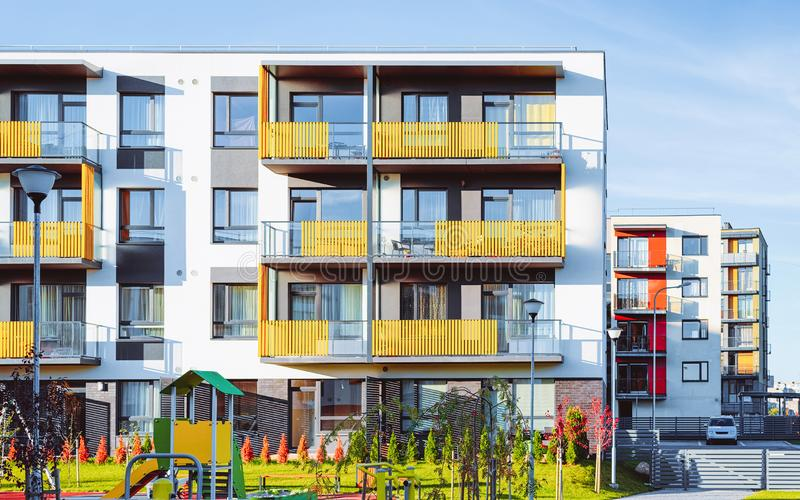 Apartment residential house facade architecture and children playgrounds. Apartment residential house facade architecture and children playground and outdoor stock photo