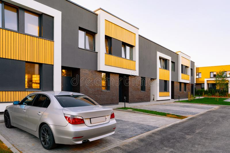 Apartment townhouse residential building and car parked. In the street stock image