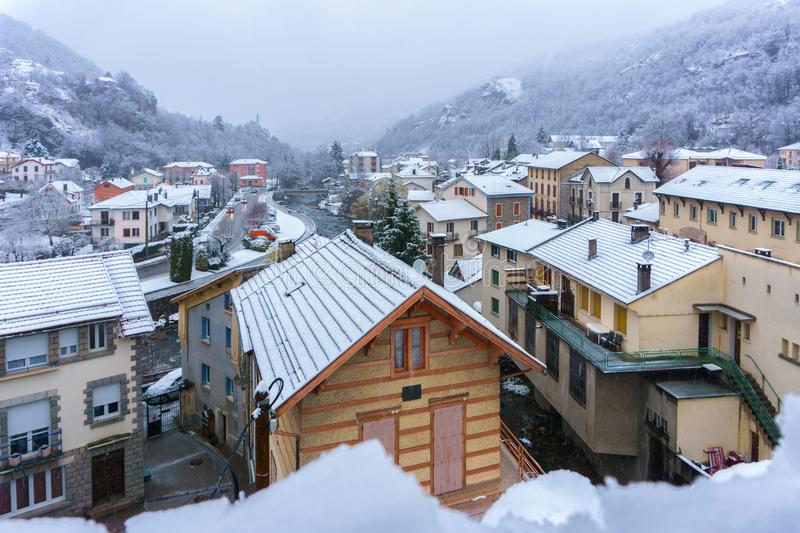 Apartments and hotel of French mountain ski resort in falling snow day, Ax-les-Thermes royalty free stock photos