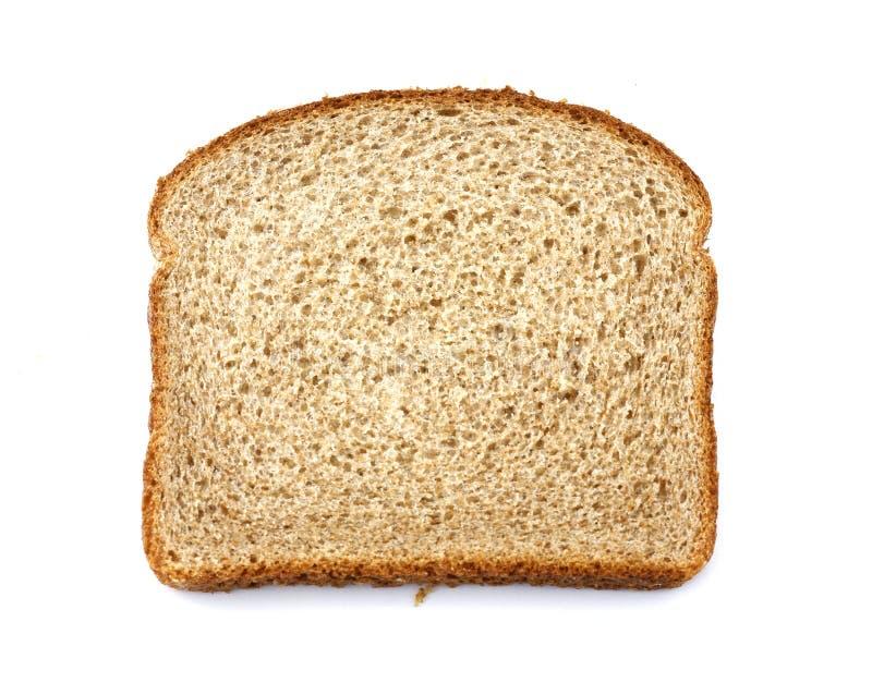 Apedreje a fatia à terra do pão de trigo inteiro fotografia de stock