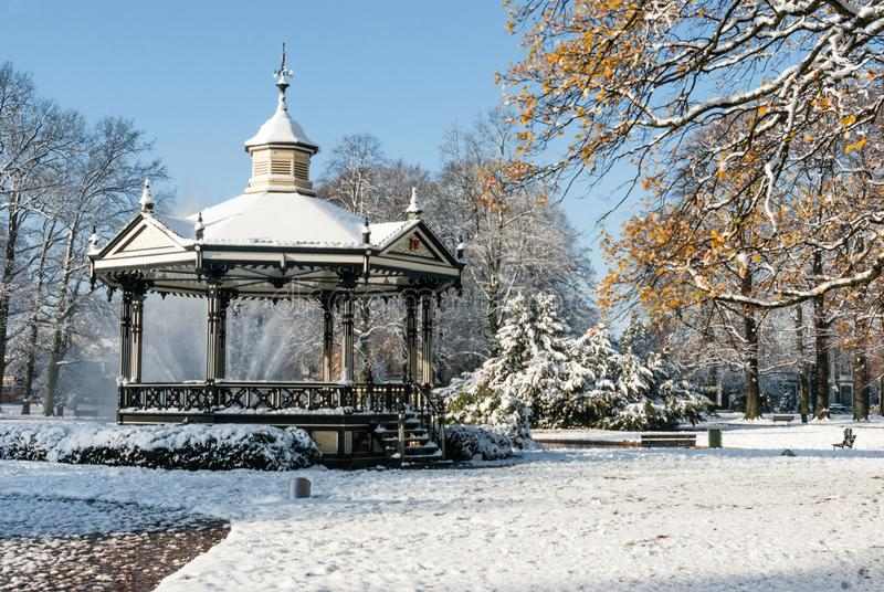 Music Kiosk in the snow. Oranje Park Apeldoorn. Apeldoorn, the Netherlands - 2008-11-24 Oranjepark: Music kiosk in the snow. A winter scenery. landscape stock images