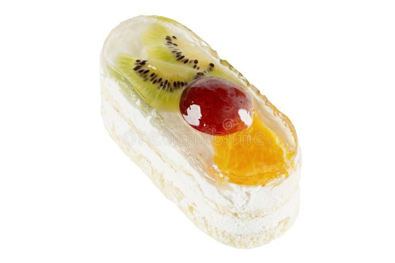 Apelmácese con el kiwi, las naranjas, las uvas con la crema blanca y la jalea imagen de archivo libre de regalías