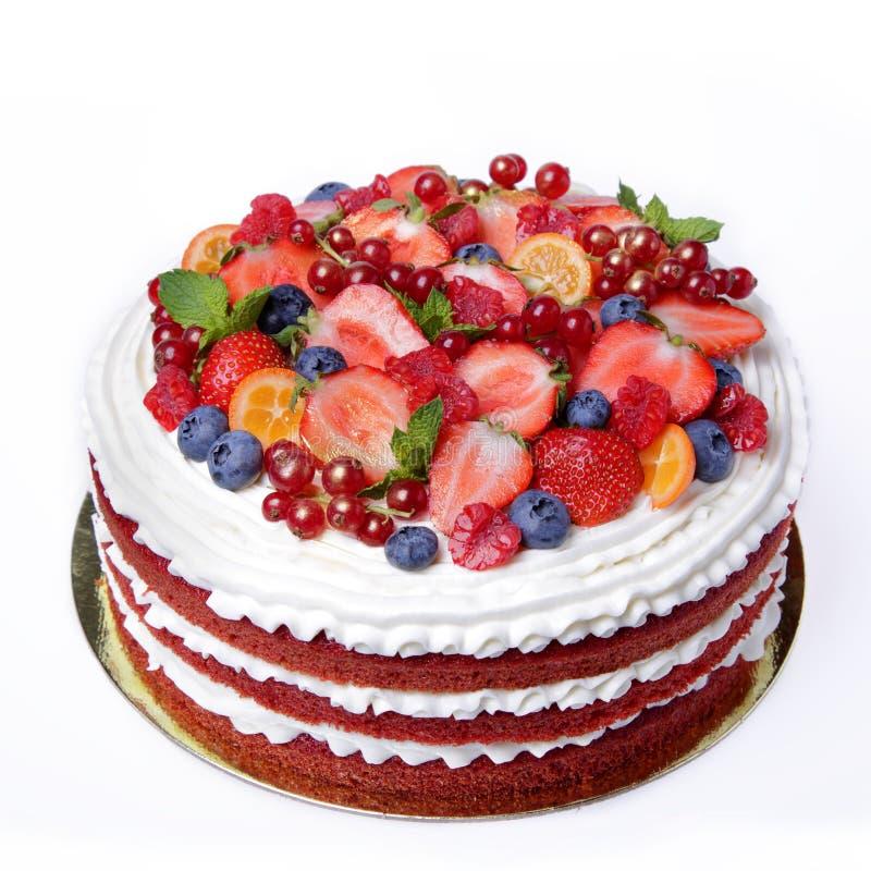 Apelmace el terciopelo rojo adornado con las bayas y las frutas foto de archivo