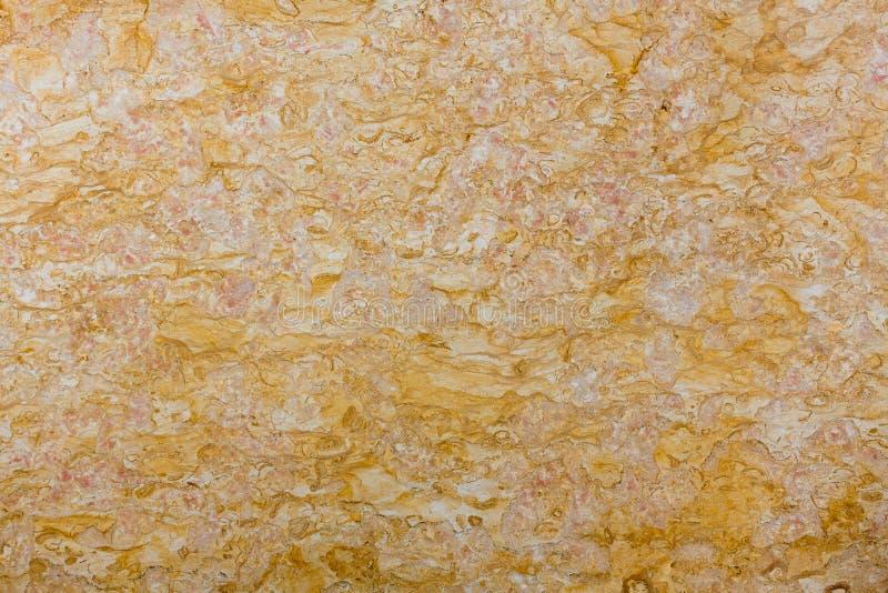 Apelsin guling, naturlig textur för guld- marmor royaltyfria bilder