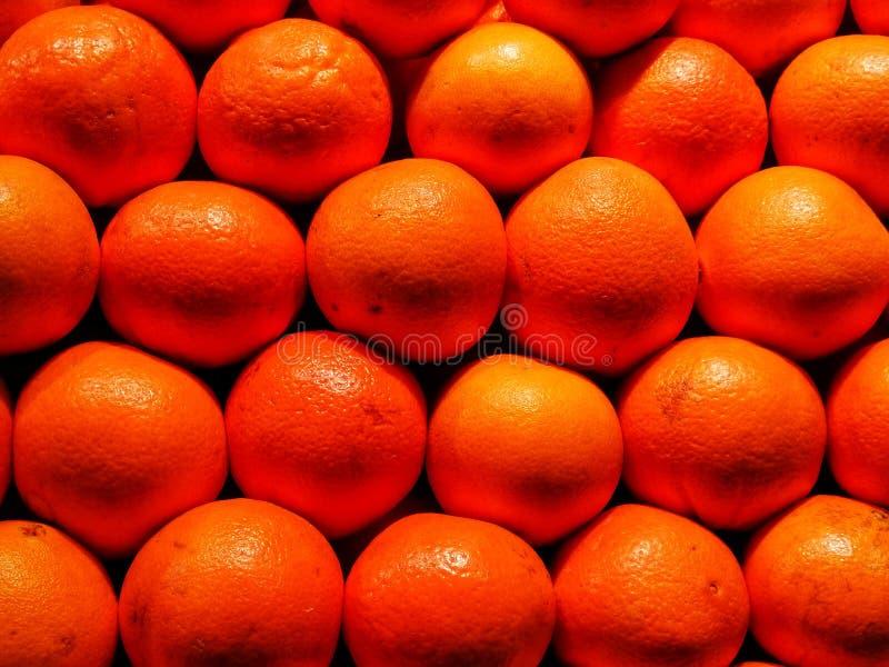 Apelsin i en marknad arkivfoton
