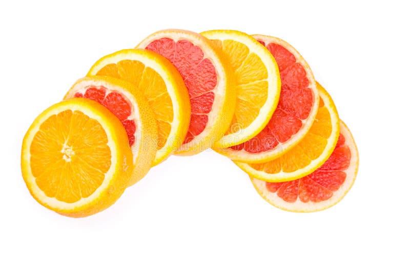 Apelsin- och grapefruktskivor arkivfoton