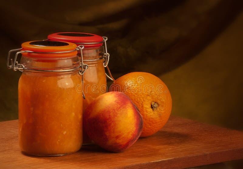 Apelsin och persikamarmelad royaltyfri fotografi