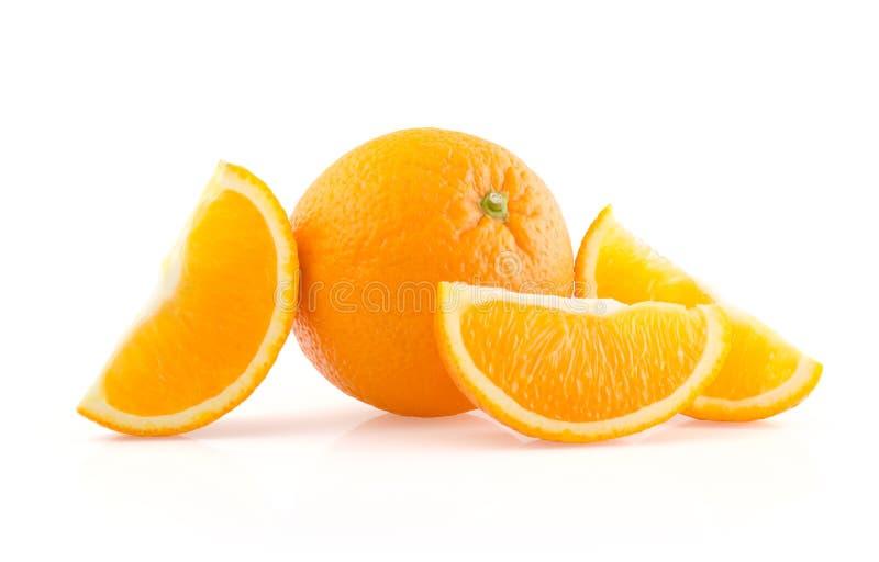 Apelsin och skivor på vit bakgrund royaltyfria foton