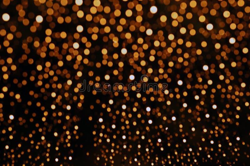 Apelsinen blänker bakgrundsbokehljus royaltyfri foto