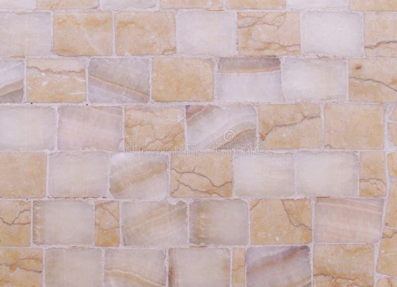 Apelsinen marmorerar mosaiktextur bakgrund arkitektur royaltyfri foto